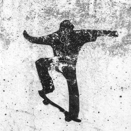 Skate themed stencil graffiti. View of a skateboarding themed stencil graffiti piece by an unidentified artist on grungy wall. It can be used as a urban theme, poster, wallpaper, design t-shirts and more.