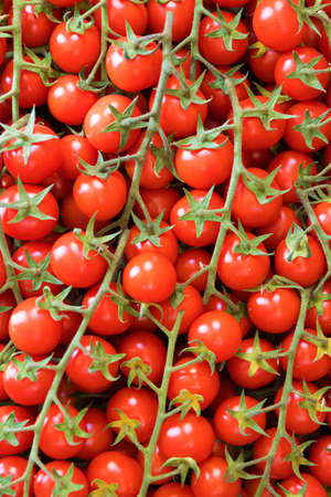 Cherry tomatoes. Healthy tomatoes background. Top view.
