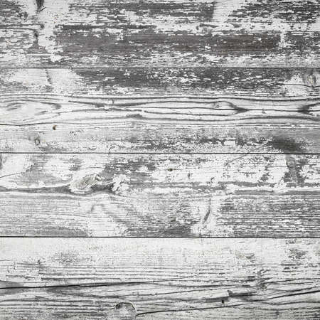 Vintage wood background. Rustic wooden planks background with peeling white paint.