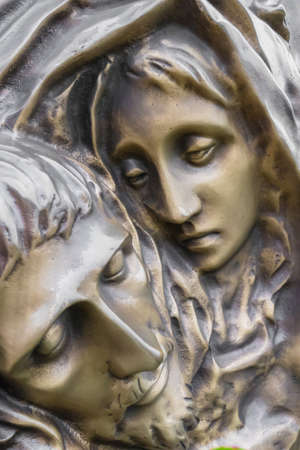 Bronze Statue of dead Jesus Christ down from the cross, being embraced by the Virgin Mary. It can be used for concepts and events.