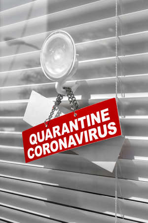 Red warning sign for Covid-19 in front of closed shop  office. Concept of stop working activities due to coronavirus medical emergency.