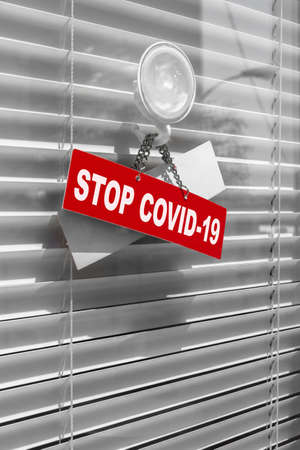 Store  office is closed for effect of corona virus or covid-19 outbreak 2020. Red warning sign for Covid-19 in front of closed shop  office. Concept of stop working activities due to coronavirus medical emergency. Banco de Imagens