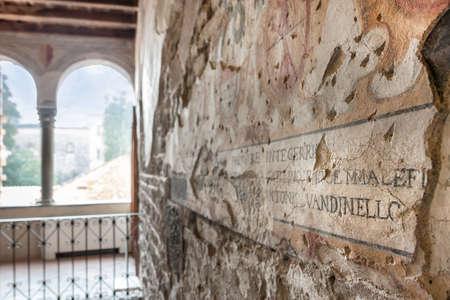 Detail of medieval fresco with Latin inscription. Bergamo, Italy.