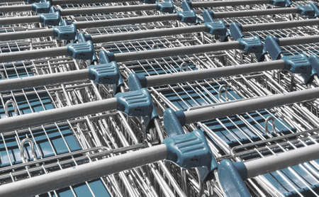 Light blue shopping trolleys in a superstore Banque d'images