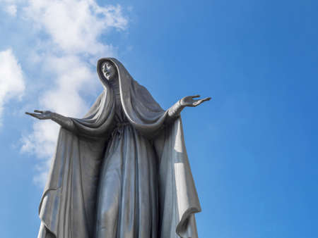 Statue of Virgin Mary. Our Lady of Fatima. Copy space on sky.