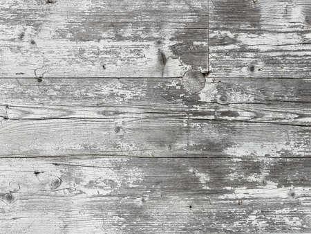 White vintage wooden planks. Old grunge wood with peeling paint. Horizontal planks.