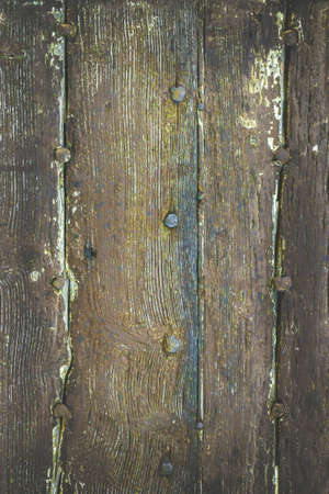 Intage image of a wooden dark background with old rusty nails. Rough and faded tones. Banque d'images