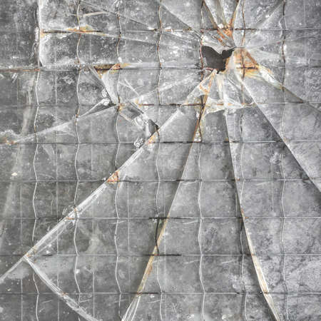 Shattered reinforced glass background. Closeup of broken glass texture. Banque d'images