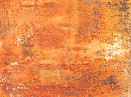 Rusty textured metal background. Grunge orange panel with oxidized or rusty marks produce a colorful painted surface that is full of texture and patterns.