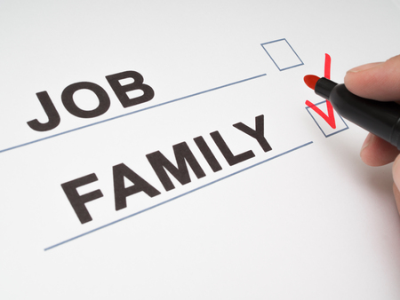 Hand a person makes a choice in the questionnaire between job and family