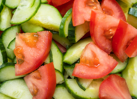 Tomatoes and cucumbers cut into slices for salad 版權商用圖片