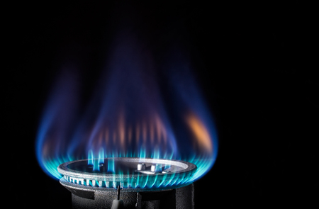 Flame of a gas burner on a dark background