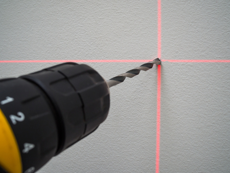 Lines of laser level on the wall for drilling