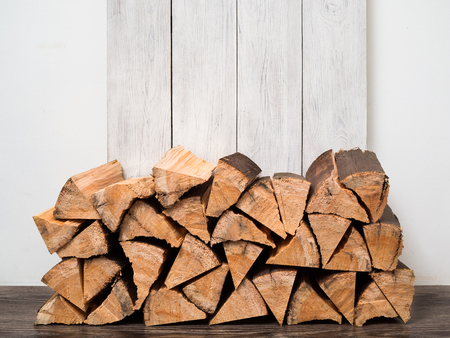 A stack of firewood stacked with a pile for firing a fireplace or stove