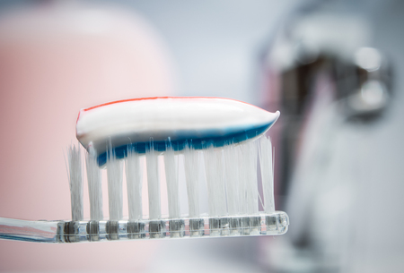 Toothbrush with toothpaste. Toothbrush on the background of the tap
