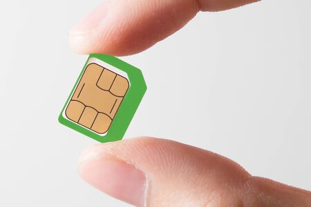 Sim card In a hand isolated on white background.