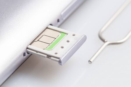 Nano sim card extract from sim card adaptor on white background