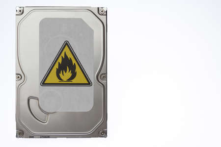 terabyte: Hard disk with a sticker indicating overheating  Stock Photo
