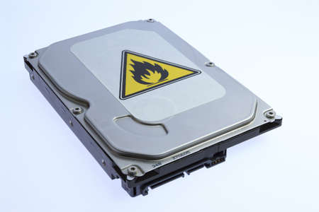 overheating: Hard disk with a sticker indicating overheating  Stock Photo