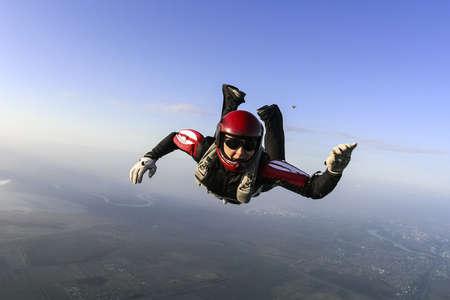 parachuting: Parachutist prepares to open the parachute