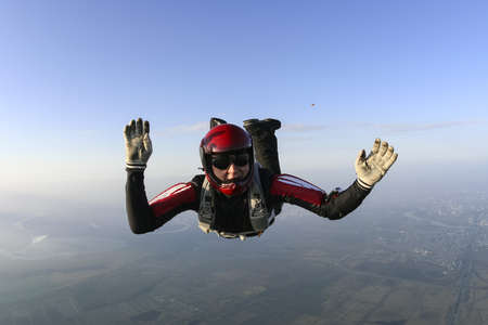 parachuting: Parachutist prepares to open the parachute. Stock Photo