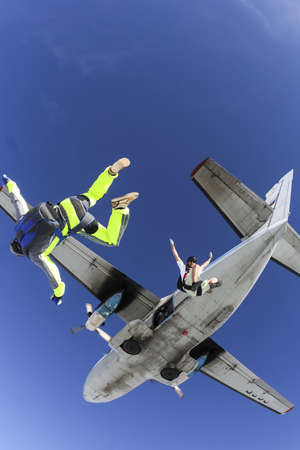 Two sports parachutist jumping out of an airplane