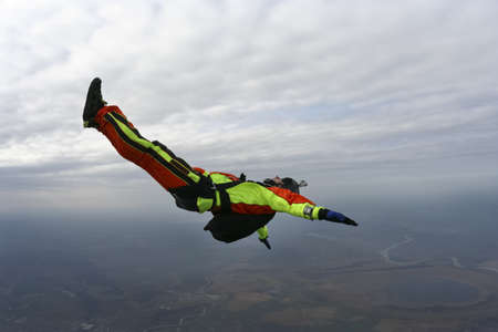 freefall: Skydiver performs figure freestyle in freefall