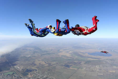 skydiving: Building a group of paratroopers ring in free fall  Stock Photo