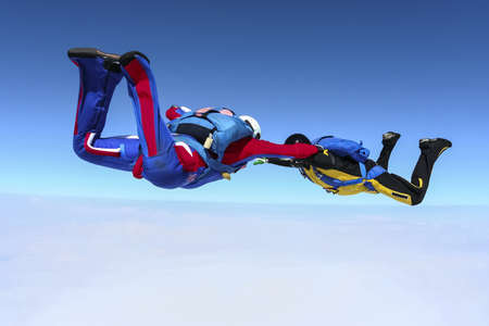 parachutists: Two parachutists construct figures in free fall  Stock Photo