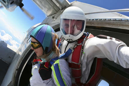 Tandem jump  Ready for jumping out of an airplane