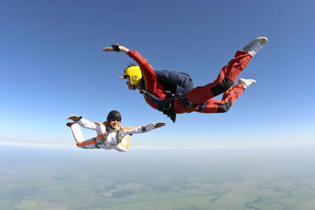 parachute jump: The student performs the task parachutist in free fall under the supervision of an instructor  Stock Photo