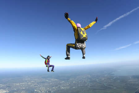 Two girls skydivers building freefall in the figure
