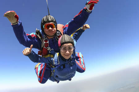 tandem: Tandem jump  Flying in a free fall  Stock Photo