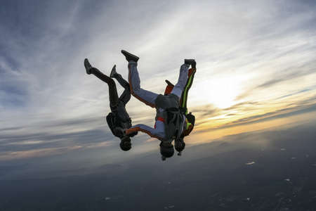 parachute jump: Three jumper in position upside down.