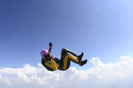 freefall: The girl parachutist performs figure freestyle in freefall  Stock Photo