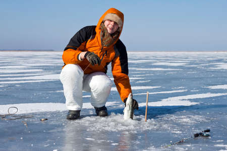 ice fishing: Woman on winter fishing