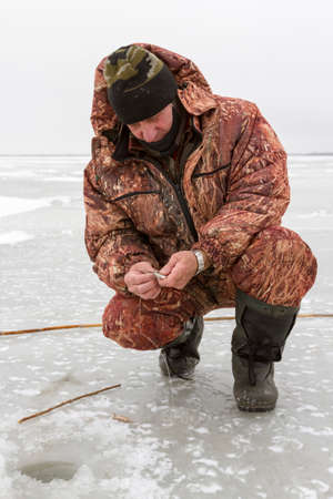 ice fishing: The man caught the fish on ice fishing
