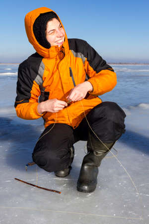 ice fishing: Girl on winter fishing.