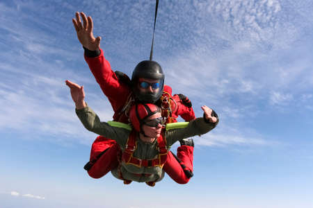 freefall: Tandem jump  The girl with the instructor in freefall  Stock Photo