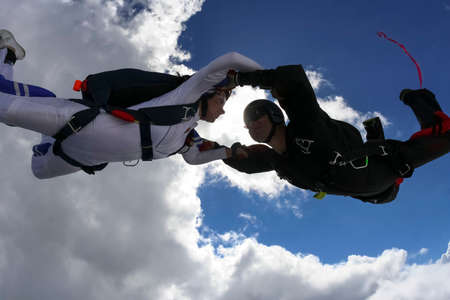 freefall: Girl and guy skydivers in freefall