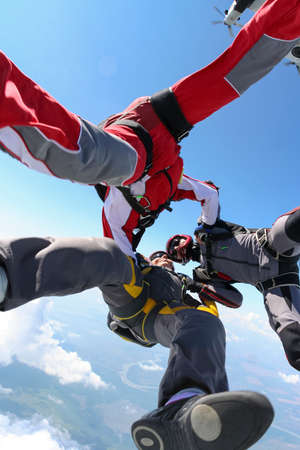 parachutists: Three parachutists jumped from a plane  Stock Photo