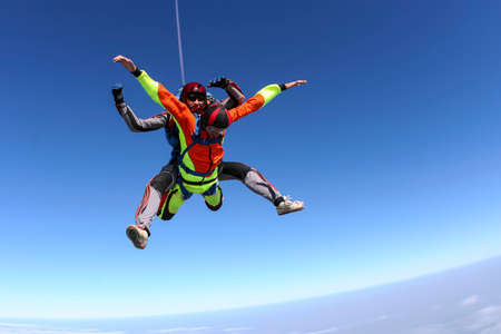 freefall: Tandem jump  A student with an instructor in freefall  Stock Photo