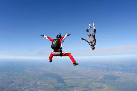 extreme danger: Two sports skydiver in free style  Stock Photo