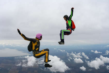 parachutists: Two girls parachutists in free style