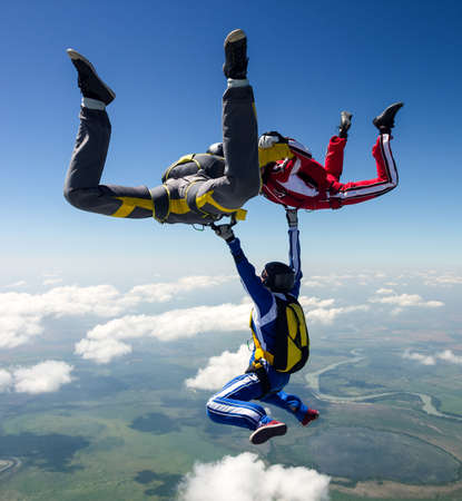 parachuting: A group of paratroopers in a free style free fall