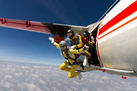 brave: Two girls parachutist jumping out of an airplane