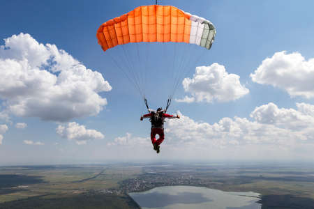 Piloting the parachute in the clouds. photo