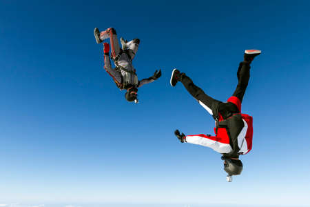 high jump: Two sports parachutist build a figure in free fall