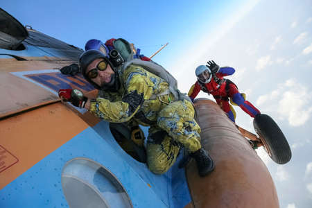 parachuting: Parachutists preparing to jump from a helicopter