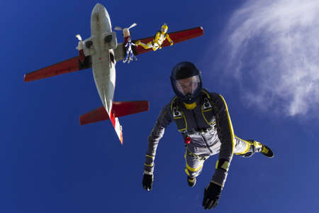 Student skydiver jumps out of an airplane